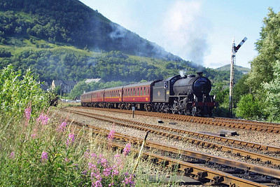 The next three images show 62005 at work in the West Highlands of Scotland on the Fort William-Mallaig 'Jacobite' services. In this photo 62005 is pictured passing Fort William Mallaig Junction Yard shortly after departure with the 1020 Fort William-Mallaig on 02/08/2002.