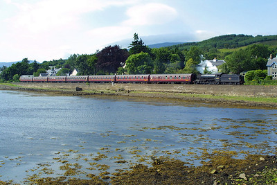Nearly at journeys end, 62005 slows for the level crossing at Corpach with the 1410 Mallaig-Fort William service on 02/08/2002. The photograph was taken from the lock gates at the western end of the Caledonian Canal.