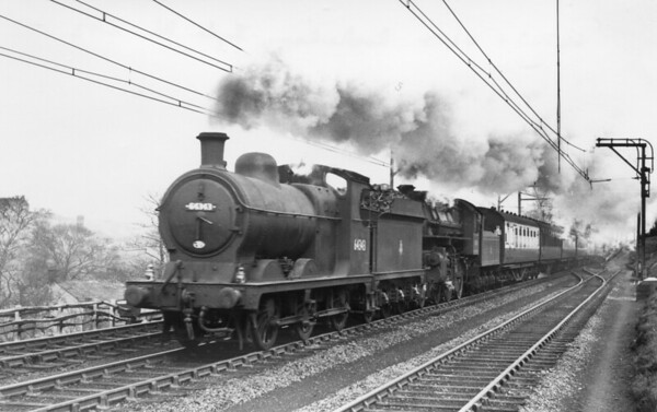 64343 leads Flying Pig 43114 unknown location on a Rotherham to Hude road service April 1953