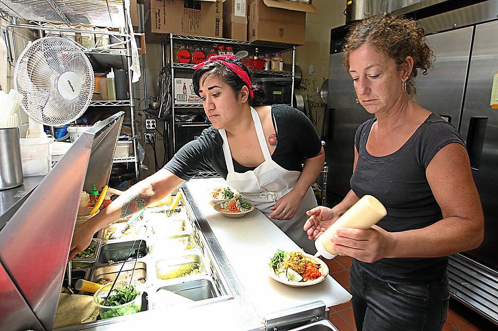. Mollie Sorensen and Fran Grayson are in the kitchen at Steamer Lane Supply. (Dan Coyro -- Santa Cruz Sentinel)