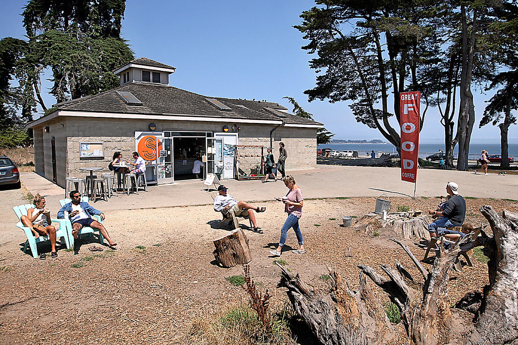 . Steamer Lane Supply has a fantastic location overlooking the world famous surf break.  Little wonder the place is busy from morning through early evening. (Dan Coyro -- Santa Cruz Sentinel)