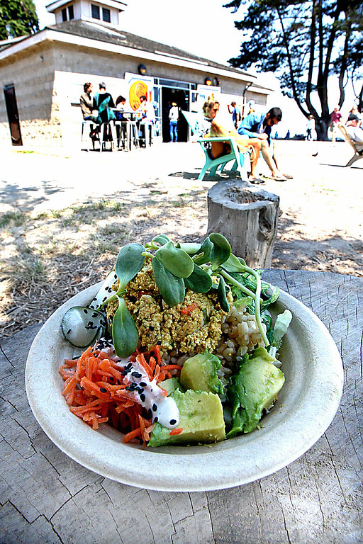. Tofu Poke Bowl is ready to eat on one of Steamer Lane Supply\'s tree stump tables. (Dan Coyro -- Santa Cruz Sentinel)