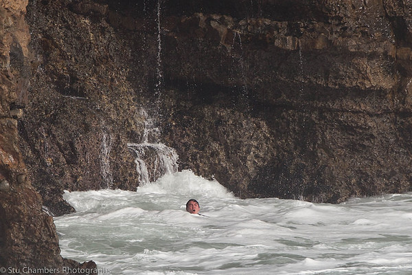 . A surfer gasps for air between waves. He is stuck against the cliffs after losing his board at Steamer Lane on Monday, amid a high surf advisory. He was rescued by a fellow surfer. (Stu Chambers Photographs -- Contributed)