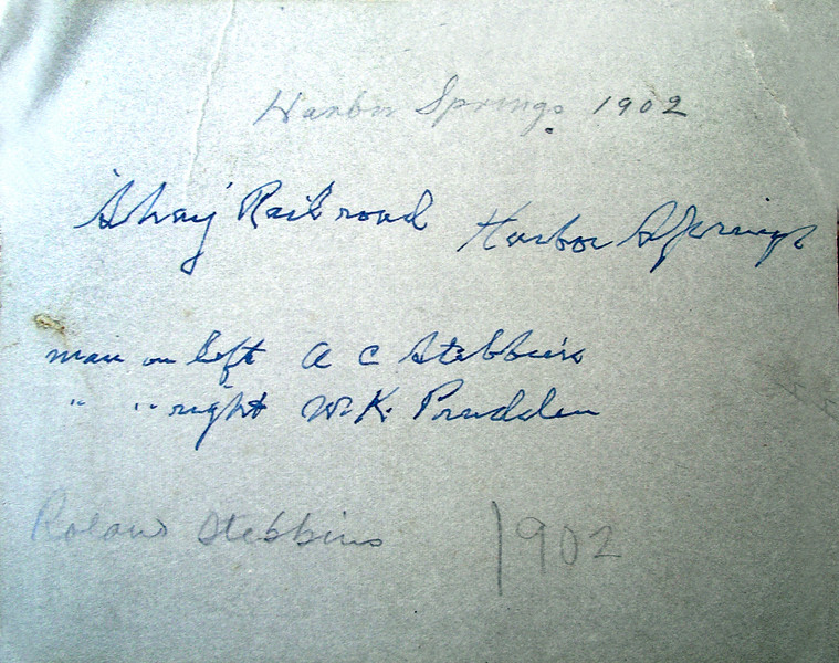 """Harbor Springs 1902 Shay Railroad.  Man on left, A.C Stebbins, Man on right W.K. Prudden."" Seems to be A C Stebbins' handwritting.<br /> ""Roland Stebbins 1902"" in a different hand.<br /> There is some confusion here. Whoever wrote ""Roland Stebbins 1902"" misspelled Rowland's name and Rowland was born in 1903, so either the child is not Rowland, or the photo is miss-labled.<br /> Thanks to Kenyon Stebbins for this photo."