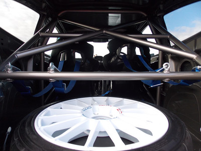 Rear area shows off the beautiful roll cage work and holds a spare OZ wheel