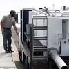 California DFW wildlife technician Joe Amoroso releases steelhead Wednesday, April 4, 2018, at the Wilbur Road Boat Launch of the Thermalito Afterbay in Oroville, California. (Dan Reidel -- Enterprise-Record)