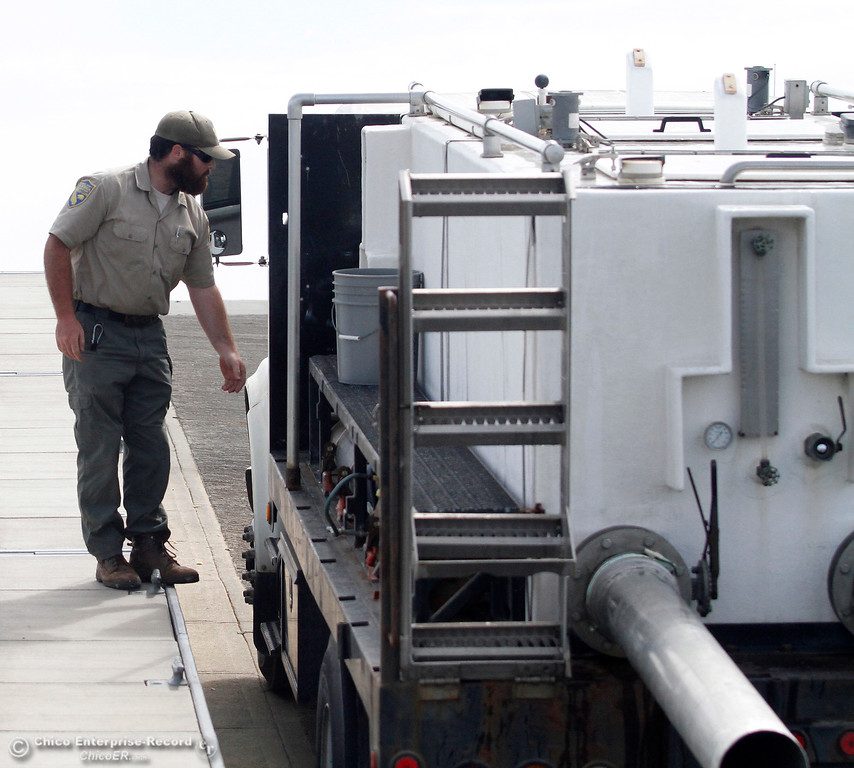 . California DFW wildlife technician Joe Amoroso releases steelhead Wednesday, April 4, 2018, at the Wilbur Road Boat Launch of the Thermalito Afterbay in Oroville, California. (Dan Reidel -- Enterprise-Record)