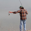 An angler lands a small steelhead Wednesday, April 4, 2018, at the Wilbur Road Boat Launch of the Thermalito Afterbay in Oroville, California. (Dan Reidel -- Enterprise-Record)