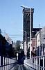 """Steendorp - zicht op de Gelaagstraat en de kerk vanop """"den barkendeir""""<br /> De nieuwe dijk was hier nog niet aangelegd. Alle electriciteitsleidingen lagen nog bovengronds."""