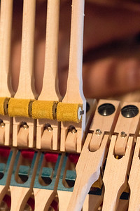 The craftsmanship involved in making a Steinway is apparent when you use a macro to capture the details of the materials involved in the process.