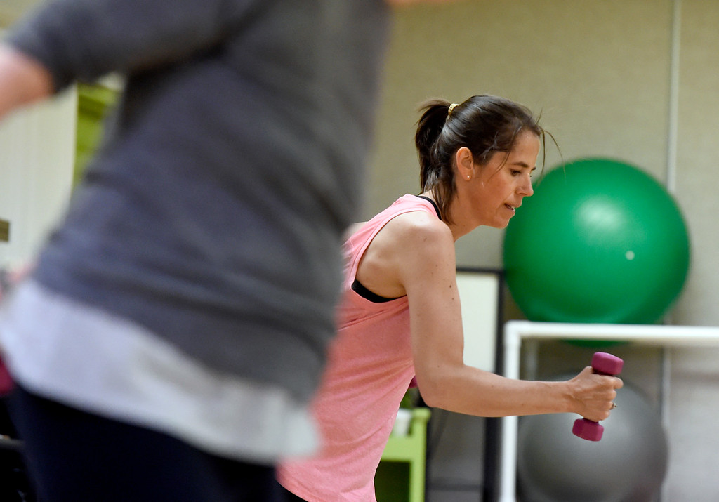 ". Kristin Love works out during a ""Step N\' Tone\"" workout class on Monday at Mountains\' Edge Fitness in Boulder. For more photos of the class go to dailycamera.com Jeremy Papasso/ Staff Photographer 06/11/2018"