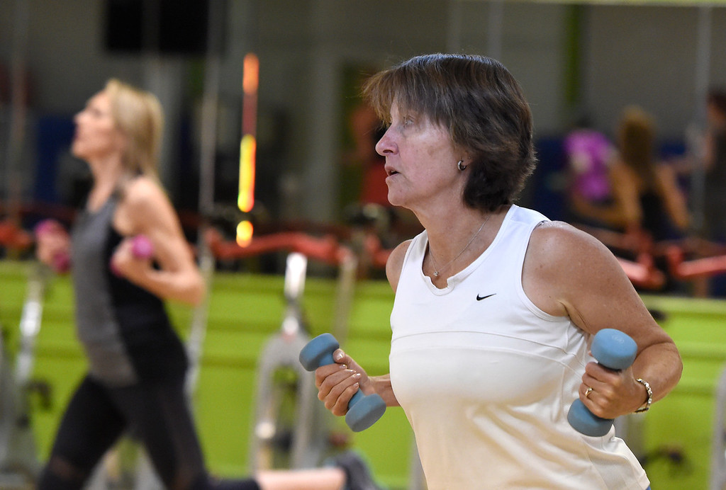 ". Janet Dilz works out during a ""Step N\' Tone\"" workout class on Monday at Mountains\' Edge Fitness in Boulder. For more photos of the class go to dailycamera.com Jeremy Papasso/ Staff Photographer 06/11/2018"
