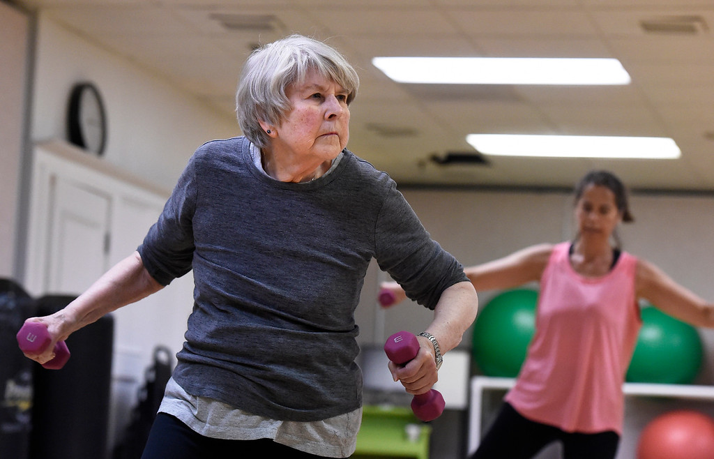 ". Karen Thompson works out during a ""Step N\' Tone\"" workout class on Monday at Mountains\' Edge Fitness in Boulder. For more photos of the class go to dailycamera.com Jeremy Papasso/ Staff Photographer 06/11/2018"