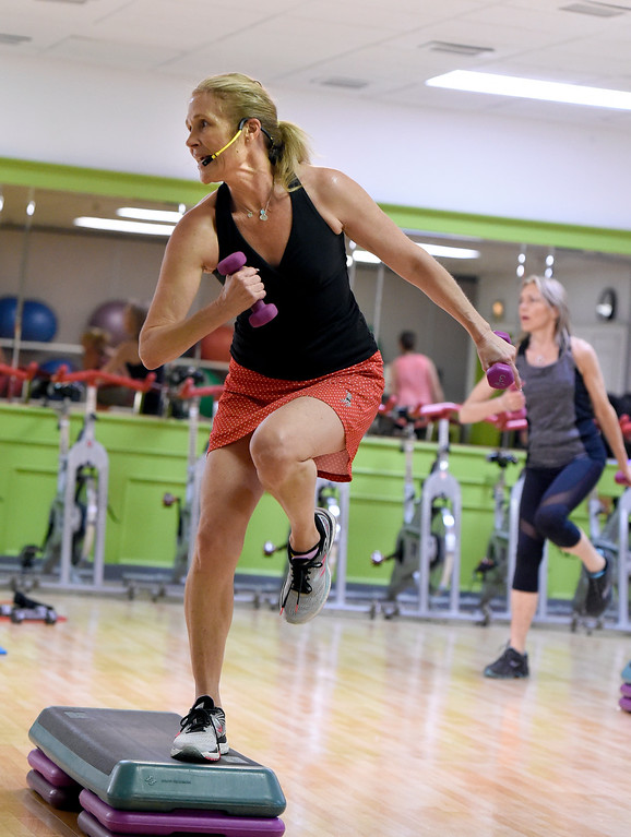 ". Instructor Mary Siefert leads her class during a ""Step N\' Tone\"" workout class on Monday at Mountains\' Edge Fitness in Boulder. For more photos of the class go to dailycamera.com Jeremy Papasso/ Staff Photographer 06/11/2018"