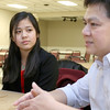 Stephanie Tam, 16, a Tewksbury Memorial High School junior, listens to her dad Gene Tam as he talks about her being a finalist in the national VFW Voices of Democracy audio-essay program. SUN/JOHN LOVE