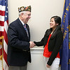 Vietnam veteran James F. Williams the Senior Vice Commander for VFW post 8164 in Tewksbury congratulates Stephanie Tam, 16, a Tewksbury Memorial High School junior for being a finalist in the national VFW Voices of Democracy audio-essay program. SUN/JOHN LOVE