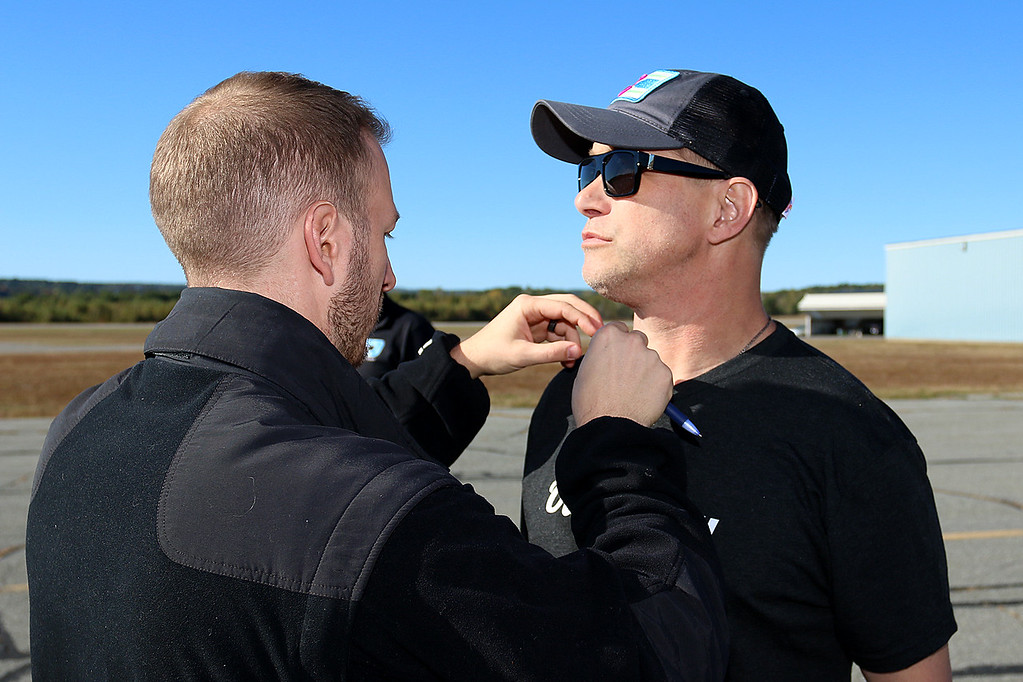 ". Stephen Baldwin was at the Fitchburg Municipal Airport on Tuesday filming his new show ""Great American Pilgrimage.\"" Baldwin gets his microphone put on as they get ready to film for the show. SENTINEL & ENTERPRISE / JOHN LOVE"
