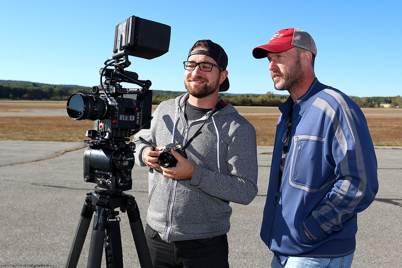 "Stephen Baldwin was at the Fitchburg Municipal Airport on Tuesday filming his new show ""Great American Pilgrimage."" Show crew members Tony Oberstar the director of photography and John McGalliard the executive producer look over one of the takes of the show. SENTINEL & ENTERPRISE / JOHN LOVE"