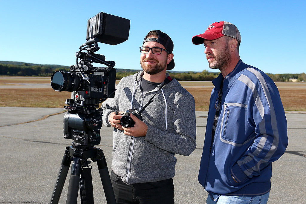 ". Stephen Baldwin was at the Fitchburg Municipal Airport on Tuesday filming his new show ""Great American Pilgrimage.\"" Show crew members Tony Oberstar the director of photography and John McGalliard the executive producer look over one of the takes of the show. SENTINEL & ENTERPRISE / JOHN LOVE"