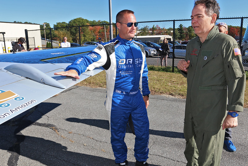 """Stephen Baldwin was at the Fitchburg Municipal Airport on Tuesday filming his new show """"Great American Pilgrimage."""" They had a Czechoslovakian jet that was being flown by pilot Scott Farnsworth. Here he explains the jet to Max Keiser, who was helping host the show, as they wait to fly it for the episode. He said it goes 500 mph. SENTINEL & ENTERPRISE / JOHN LOVE"""