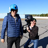 "Stephen Baldwin was at the Fitchburg Municipal Airport on Tuesday filming his new show ""Great American Pilgrimage."" Max Keiser tries on the fight helmet he was going to wear in Czechoslovakian jet they had on set at the airport for the episode.  SENTINEL & ENTERPRISE / JOHN LOVE"