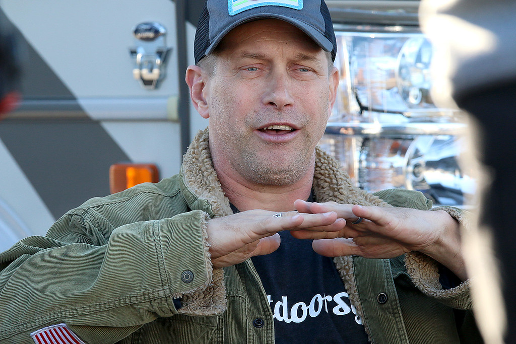 ". Stephen Baldwin was at the Fitchburg Municipal Airport on Tuesday filming his new show ""Great American Pilgrimage.\"" Baldwin chats with others in the show during filming. SENTINEL & ENTERPRISE / JOHN LOVE"