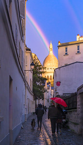 A view of Sacré-Cœur from Rue Saint-Rustique after a late-afternoon shower.