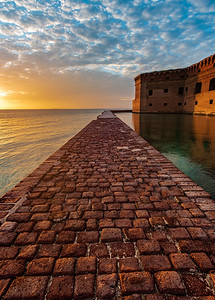 A view of Fort Jefferson at Dry Tortugas National Park during the golden hour before sunset.