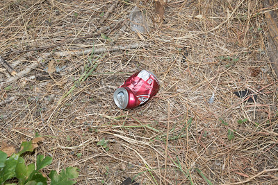 Soda can left on side of house (we don't drink soda)