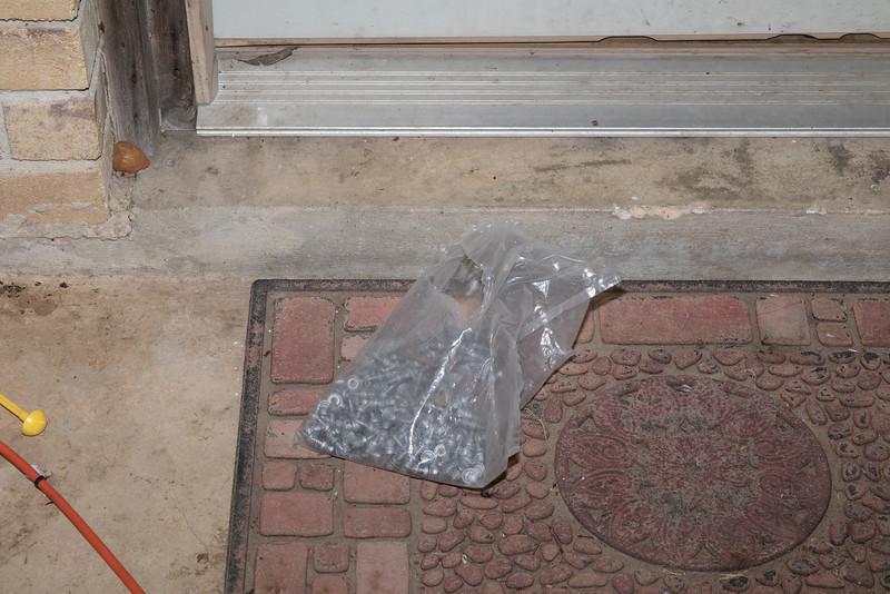 Bag of decking screws left RIGHT AT MY FRONT DOOR.