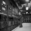 Dr. J.W. Mauchly with the electronic computing machine known as the ENIAC.