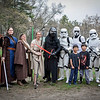 In front, Lee Sawyer, 8, from Westford and Carter Vercauteren, 9, from North Chelmsford take a group photo with Star Wars characters from Alderaan Base, a group that assists charities in fundraising and voulunteerism. SUN/Caley McGuane