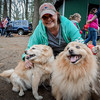 Cindy Graves of Lowell takes a photo with her Pomeranian Chows, Ricky and Teddy at the Steps for Pets event in Westford. SUN/Caley McGuane