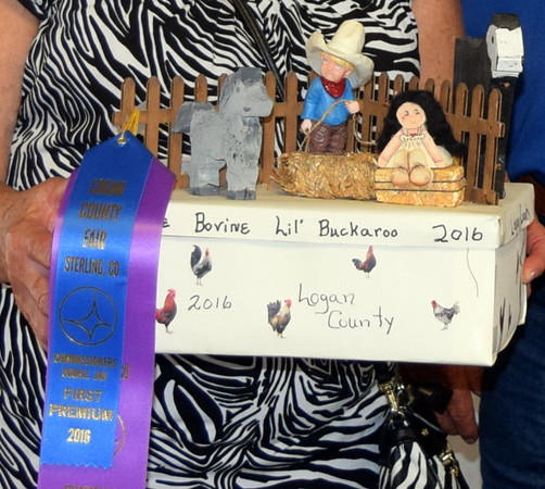 "Luanne Shafer's award winning cookie jar fit the theme of this year's Logan County Fair perfectly, ""Equines, Bovines and Little Buckaroos."""
