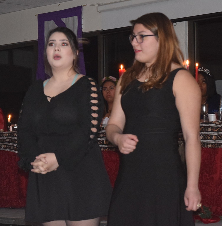 """. The Sisters Grimm, Moderately Grimm (Kimberly Morales) and Relatively Grimm (Genevette Jimenez), tell the story of Rapunzel during a theatrical performance of \""""Rapunzel, Rapunzel, Let Down Your Heir\"""" at Sterling High School\'s 30th annual Madrigal Dinner Monday, Dec. 4, 2017."""