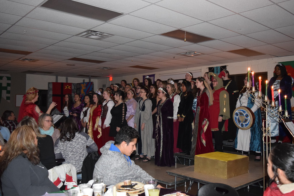 """. The Sterling High School Women\'s Choir performs \""""Bring a Torch, Jeanette Isabella,\"""" under the direction of Annette Lambrecht, at the school\'s 30th annual Madrigal Dinner Monday, Dec. 4, 2017."""