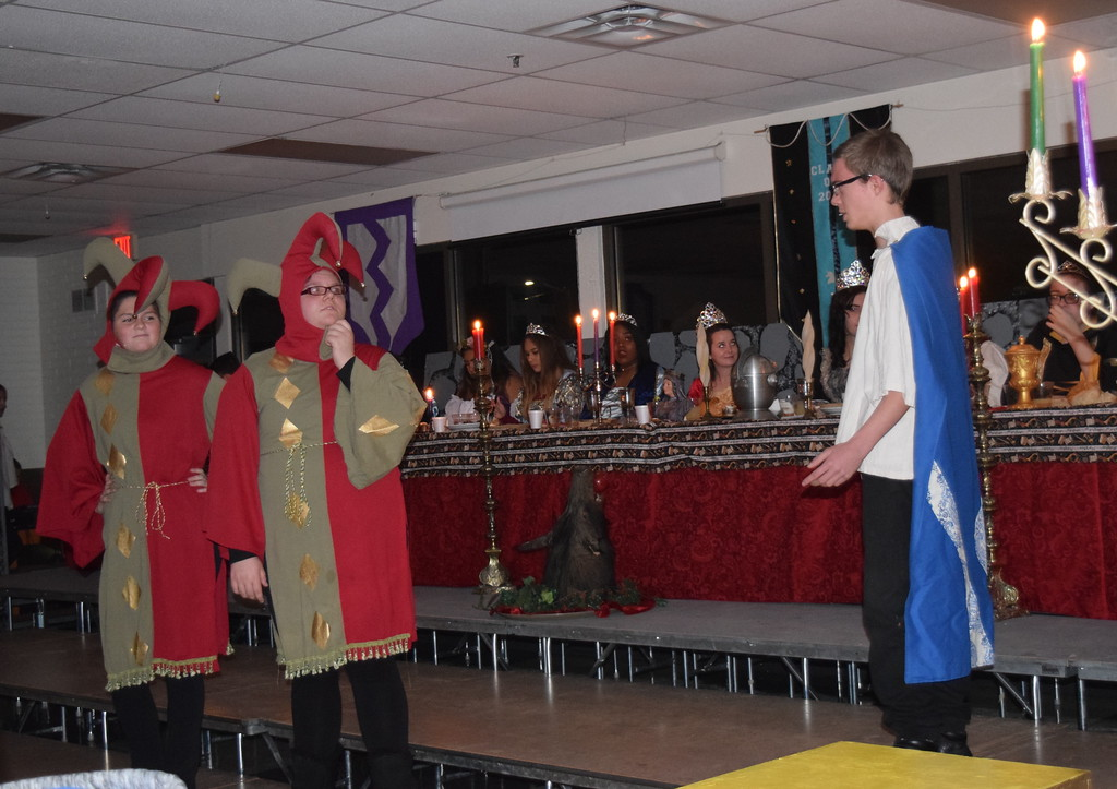 """. The Jesters (Dakota Schneider and Katie von Steinman) find their Handsome Prince (James Blanton) for the story of Rapunzel during a theatrical performance of \""""Rapunzel, Rapunzel, Let Down Your Heir\"""" at Sterling High School\'s 30th annual Madrigal Dinner Monday, Dec. 4, 2017."""