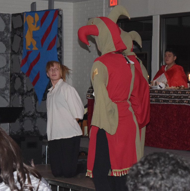 """. The Jesters (Dakota Schneider and Katie von Steinman) consider Small Boy (Camden Shepherd) for a part in the story of Rapunzel during a theatrical performance of \""""Rapunzel, Rapunzel, Let Down Your Heir\"""" at Sterling High School\'s 30th annual Madrigal Dinner Monday, Dec. 4, 2017."""