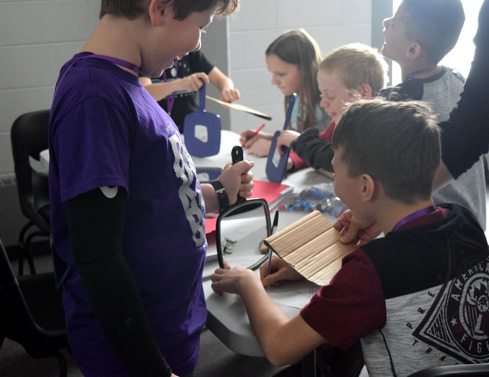 . Students test their memory skills as they try to draw a star using a mirror during one of the workshops at Brain Awareness Day presented by the Intermountain Neuroimaging Consortium Friday, Feb. 8, 2019.
