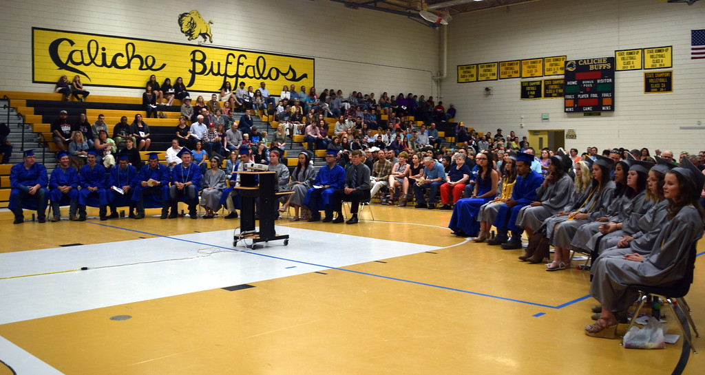 . The class of 2017 listens to remarks at Caliche High School\'s commencement exercises Saturday, May 27, 2017. This year Caliche graduated 21 students.