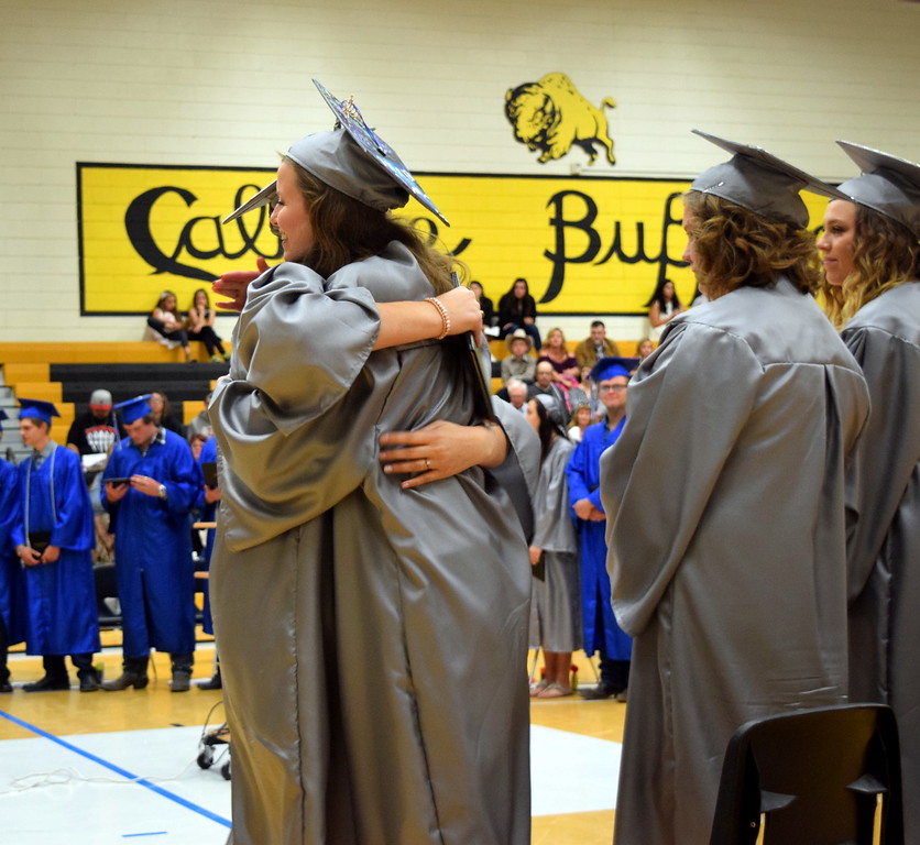 . Madison Fryrear gives a hug to Isabel Erker after Erker received her diploma at Caliche High School\'s commencement exercises Saturday, May 27, 2017.