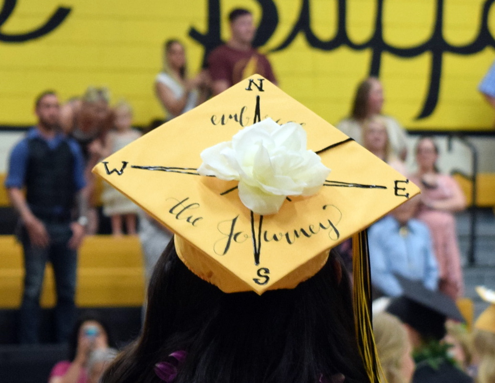 . Embrace the journey reads the cap of one of the Caliche High School graduates at commencement exercises Saturday, May 25, 2018.