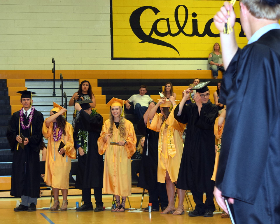 . Caliche High School graduates filp their tassels during commencement exercises Saturday, May 26, 2018.
