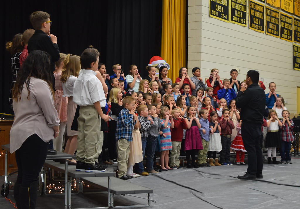 ". Caliche Elementary kindergarten through fourth grade students perform ""Rudolph the Red Nosed Reindeer,\"" under the direction of Ryan Rosete, Tuesday, Dec. 5, 2017, at the school\'s Christmas Celebration."