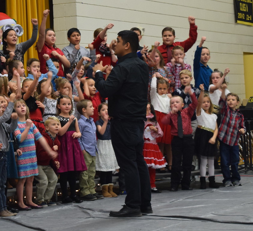 ". Caliche Elementary kindergarten through fourth grade students perform ""Jingle Bell Rock,\"" under the direction of Ryan Rosete, Tuesday, Dec. 5, 2017, at the school\'s Christmas Celebration."
