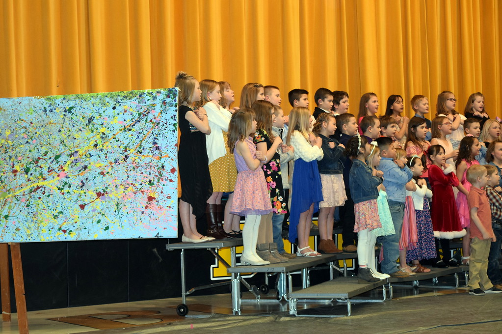 ". Caliche Elementary kindergarten through fourth graders perform ""Try Everything,\"" under the direction of Ryan Rosete, at the school\'s Visual and Performing Arts Show Tuesday, Feb. 26, 2019. Beside them is one of the visual art pieces that was on display."