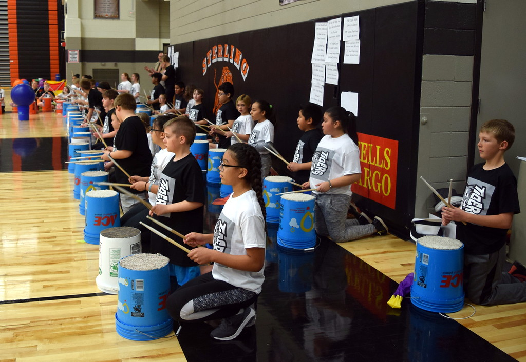 ". Fifth graders pound bucket drums to ""We Will Rock You\"" at Campbell Elementary\'s Music and P.E. Showcase on Tuesday, March 6, 2018."