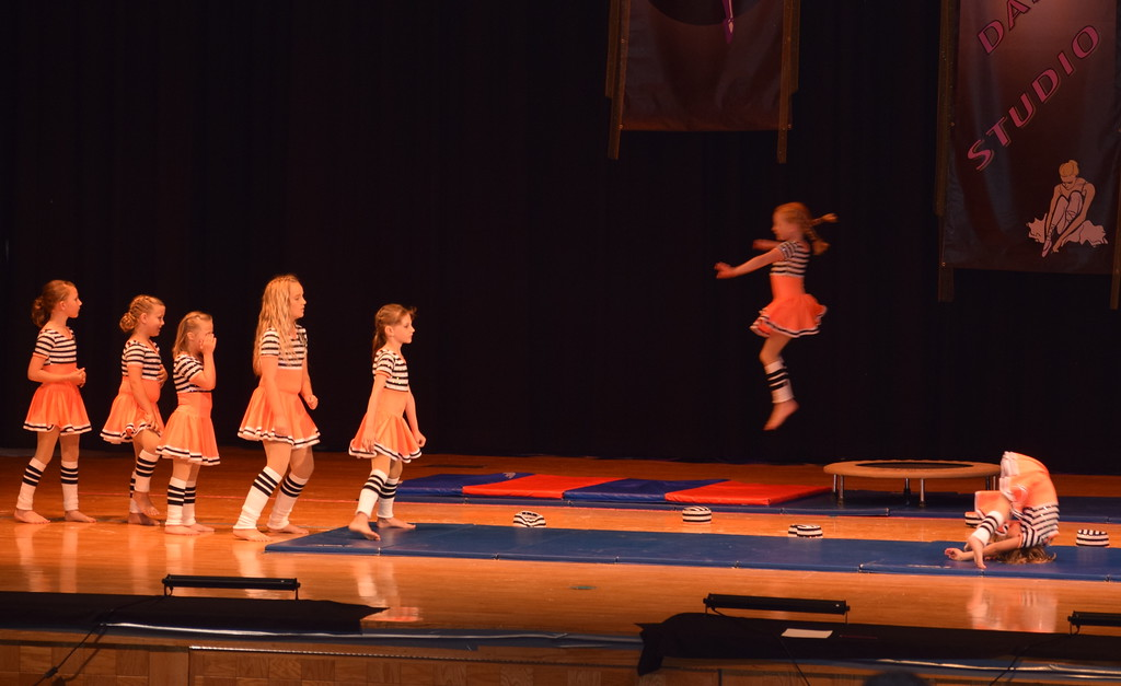 """. Jordan Kuehl, Cedi Ball, Faye Lueck, Taylor Fouch, McKinzie Sides, Clare Moos and Bridgette Moos perform gymnastics moves to \""""Jail House Rock\"""" at Durante\'s Dance Studio\'s spring recital Saturday, June 10, 2017."""