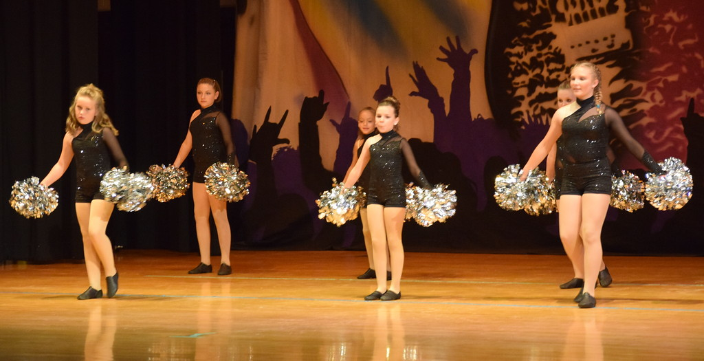 ". MaKenzie Beck, Bailey Workman, Courtney Canada, Taryn Seifried, Hadley Kerst, Jaiden Steele, Livie Ziegler, Rylan Knorr and Hadley Kerst dance to \""I Live Rock N\'Roll/You Shook Me All Night Long\"" during Durante\'s Dance Studio\'s \""Dancing to the 80\'s\"" recital Saturday, June 9, 2018."