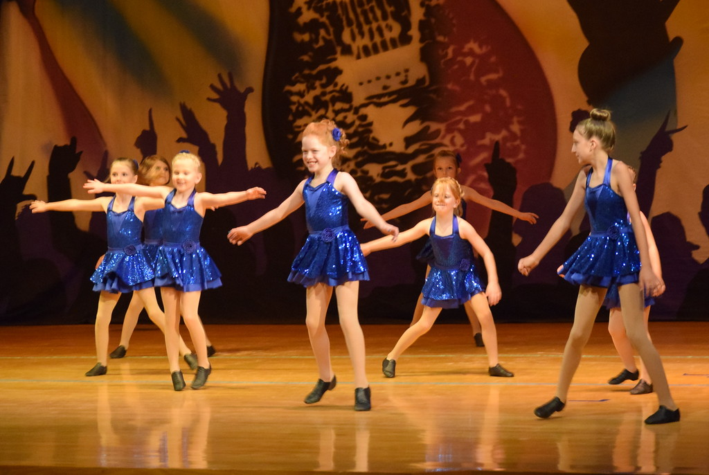 """. Jordan Fisher, Piper Withers, Zooey Knorr, Zara Connors, Amelia Hupke, Katelynn Fisher, Hallie Lopez and Emory Monheiser dance to \""""Can\'t Even Get the Blues\"""" during Durante\'s Dance Studio\'s \""""Dancing to the 80\'s\"""" recital Saturday, June 9, 2018."""